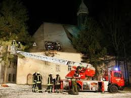 car in church roof