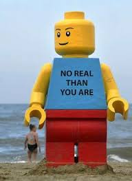 A giant, smiling Lego man was