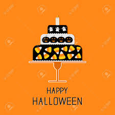 halloween black background image cake with candy corn pumpkin ghost and candle happy halloween