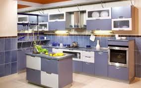 cozy blue design accent color on cabinets white subway tile