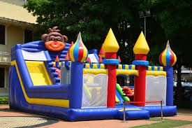 3 tips for hosting your own backyard carnival bounce houses