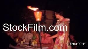 1966 tiki torch tropical hawaiian theme night time backyard