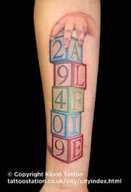 of blocks with letters spelling name tattoos cosmic