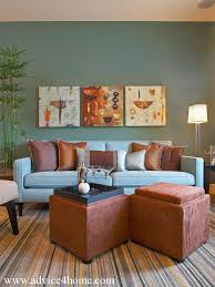 sofa and dark blue wall with photos in living room