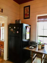 how to trim cabinet above refrigerator open shelving and fridge cabinet