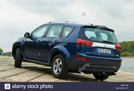 blue peugeot blue peugeot 4007 suv at rhine river rear view stock photo