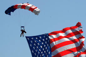 The Amarican Flag Stock Photo Of A Soldier Parachuting Past An American Flag
