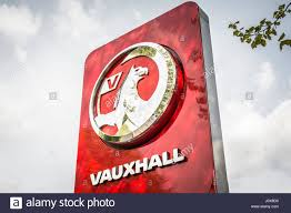 vauxhall griffin vauxhall car logo and cars on a garage forecourt in london stock