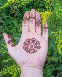 small henna sun on palm in 2017 photo pictures