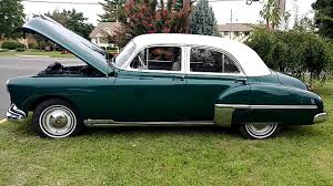1949 metallic dark emerald green oldsmobile 88 4 door sedan white