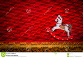 redcolor happy new year little rocking horse riding over textured red