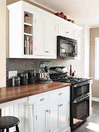 white cabinets with butcher block countertops update your kitchen on a budget black appliances white cabinets