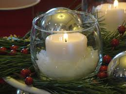 White Christmas Centerpieces - ideas for christmas centerpieces by white candle with snow on the