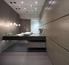 bathroom tile idea use large tiles on the floor and walls 18