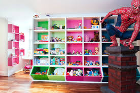 white attic stule child u0027sroom with pink and green storage cubes