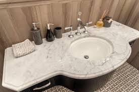the different uses of white marble in a bathroom