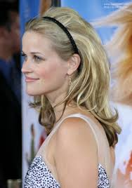 side view of pulled back hair in a bun reese witherspoon wearing her hair with height volume and a hair band