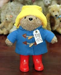 where is paddington from why does he a blue coat and