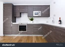 modern fitted kitchens contemporary modern fully fitted kitchen brown stock photo
