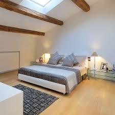 laminate bedroom flooring ideas soft thick gray blanket bed modern