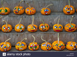 display of decorated halloween pumpkins for sale stock photo