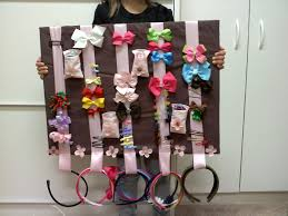 hair accessories organizer ribbon in loops for headbands and pockets tacked to board for