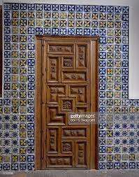 dining room door in carved wood and azuleros paneling from puebla