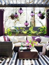 outdoor furniture with purple accent hanging lights pictures