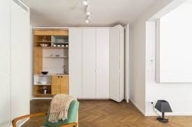 hidden kitchen in modern apartment