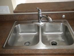 Quick And Easy Ways To Clean Your Kitchen Sink Properly - Cleaning kitchen sink with baking soda