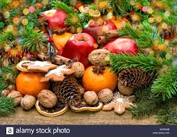 fruits nuts cookies and spices with christmas tree branches