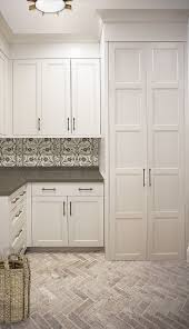 laundry room floor cabinets laundry room with white cabinets black and white backsplash tile