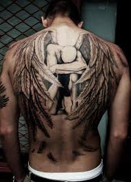 wings and cross tattoos