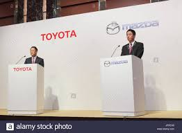 toyota motor group l to r toyota motor corporation president akio toyoda and mazda
