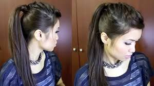 nicole scherzinger french braid edgy ponytail hairstyle for medium