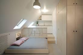 Attic Area by Renovation Transforms Paris Attic Into Efficient Modern Studio