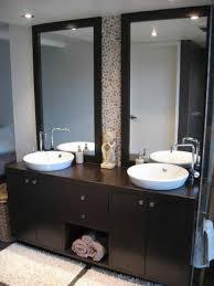 double bathroom vanities with dark wood and vessel sinks and