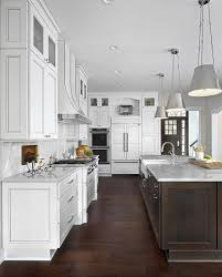 brown and white kitchen cabinets white kitchen with brown island and white marble
