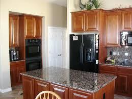 kitchen designs with black appliances rustic brown ceramic floor