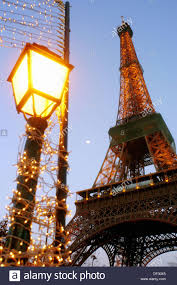 eiffel tower christmas lights eiffel tower and lightpost wrapped in christmas lights paris
