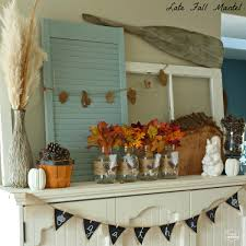 mason jar home decor late fall mantel with diy burlap feather wrapped mason jars the
