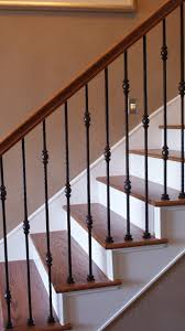 interior railing with wood handrails also foyer chandelier and