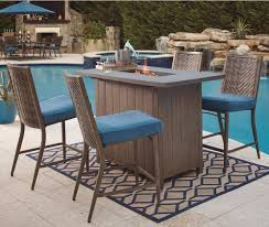 Patio Furniture Syracuse Ny by Ashley Signature Design Partanna 5 Piece Bar Table With Fire Pit