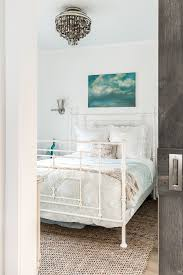 art above headboard with pocket door bedroom beach style and dark