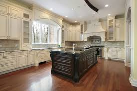 white kitchen cabinets with black island traditional antique white kitchen cabinets kutskokitchen