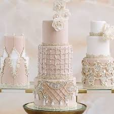 blush vintage wedding cake with crystal and tassel embellishments