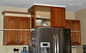How To Install Kitchen Cabinet Crown Molding Adding Height To The Kitchen Cabinets Tempting Thyme