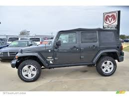 4 door jeep wrangler jacked up dark charcoal pearl 2010 jeep wrangler unlimited sahara 4x4