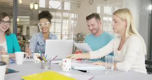 3 adults working in casual startup office rack focus
