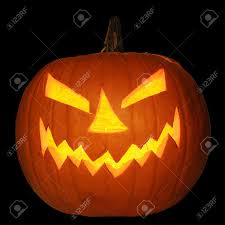 halloween scary background scary halloween pumpkin jack o lantern candle lit isolated on